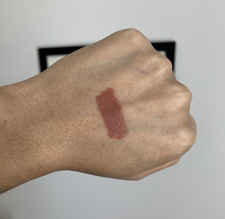 Bite beauty power move creamy matte lip crayon calvados swatch on dark skin