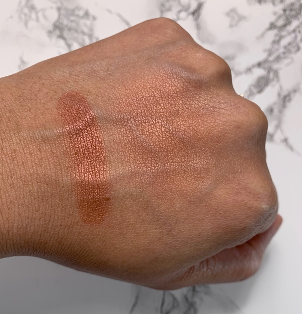 NARS Powder Blush Savage swatch on dark skin
