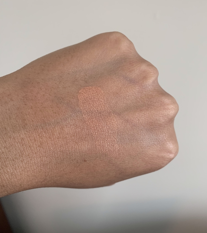 MAC mineralize skinfinish cheeky bronze highlighter swatch on dark skin