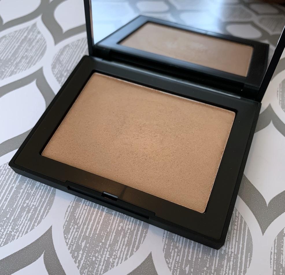 NARS Highlighting Powder in Ibiza swatches on medium dark skin