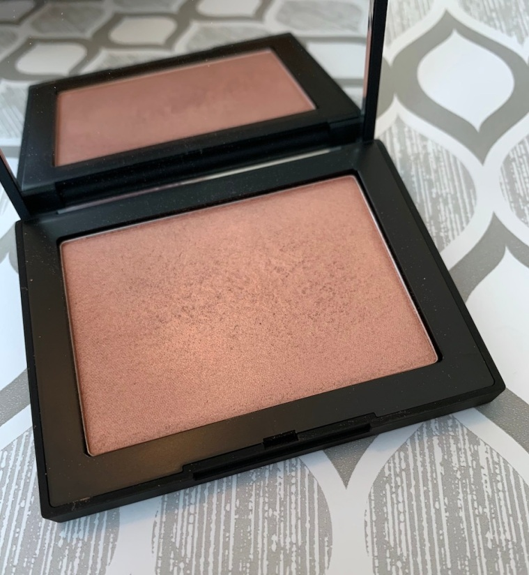 NARS Highlighting Powder in Maldives swatch on medium dark skin