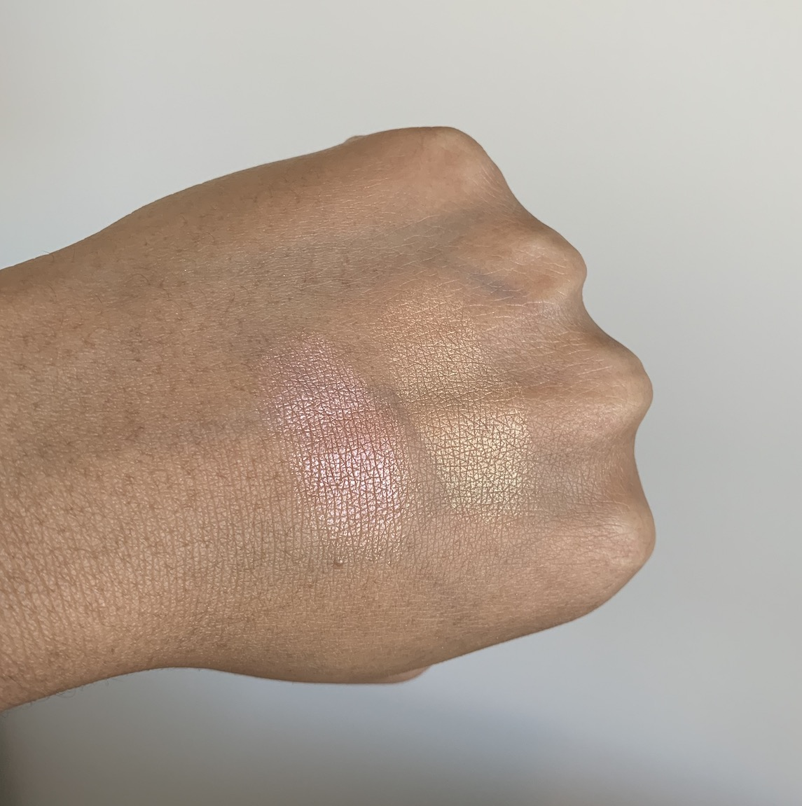 NARS Highlighting Powder in Maldives and Ibiza swatches on medium dark skin NC44/NC45