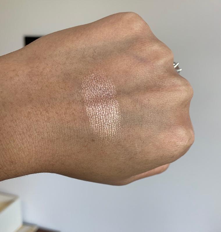 Milani Baked Highlighter 130 Rose Italiana Swatch on dark skin