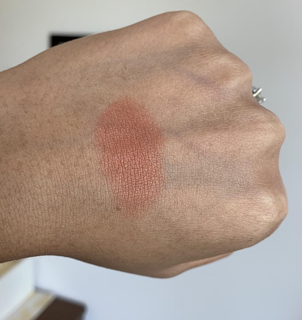 Milani Rose Powder Blush in Spiced Rose Swatch on medium dark skin