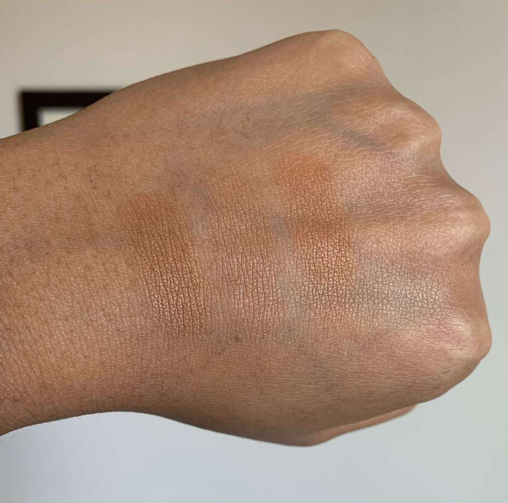Swatches of Laura Mercier Candleglow Sheer Perfecting Powder (5), MAC Studio Waterweight Pressed Powder (dark), and NARS Light Reflecting Pressed Setting Powder (sunstone)