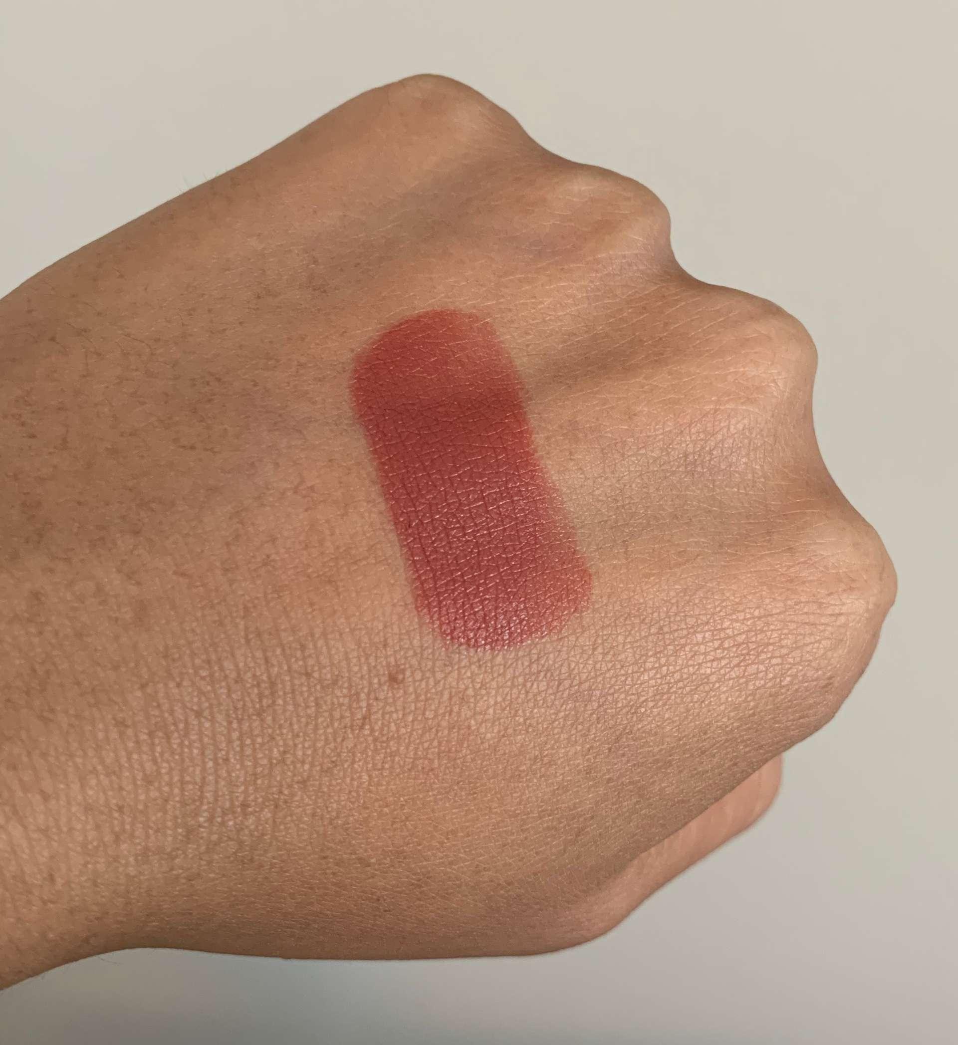 NARS Satin Lipstick Banned Red swatch medium dark skin