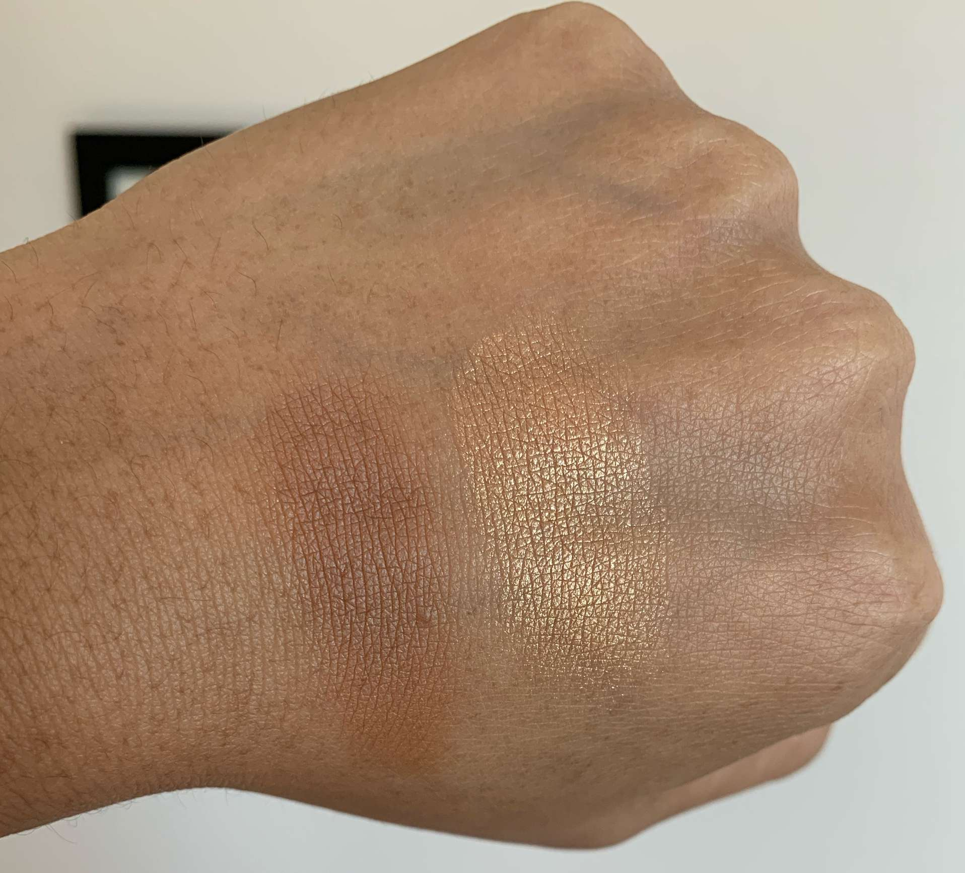 MAC Sun-Soaked Strip Bronzer and Selena La Layenda Highlighter swatches on Medium Dark Skin