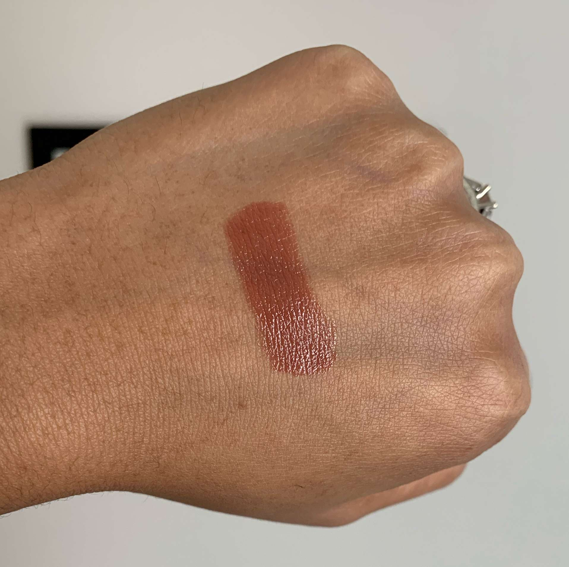 Huda Beauty Money Maker Power Bullet Cream Glow Hydrating Lipstick Money Maker Swatch on Medium Dark Skin