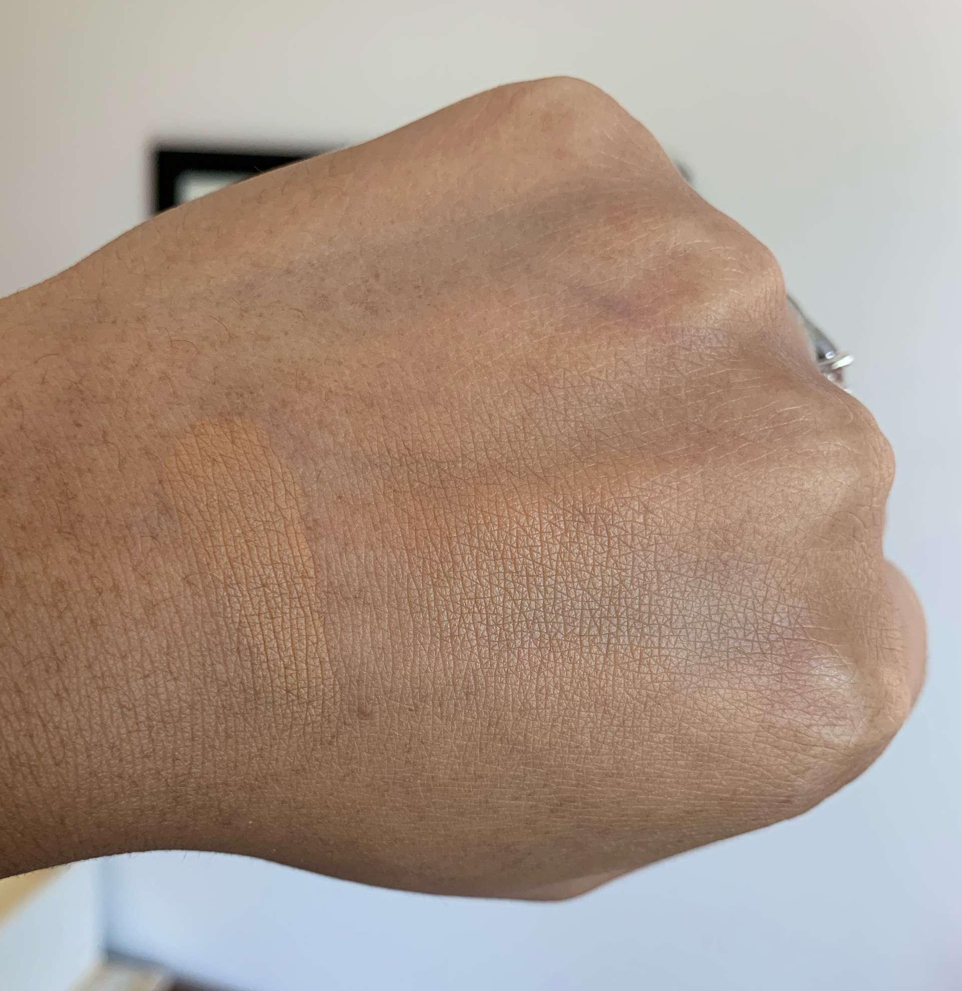 L'oreal Age Perfect Creamy Powder Foundation 340 Caramel Beige Swatch on Medium Dark Skin