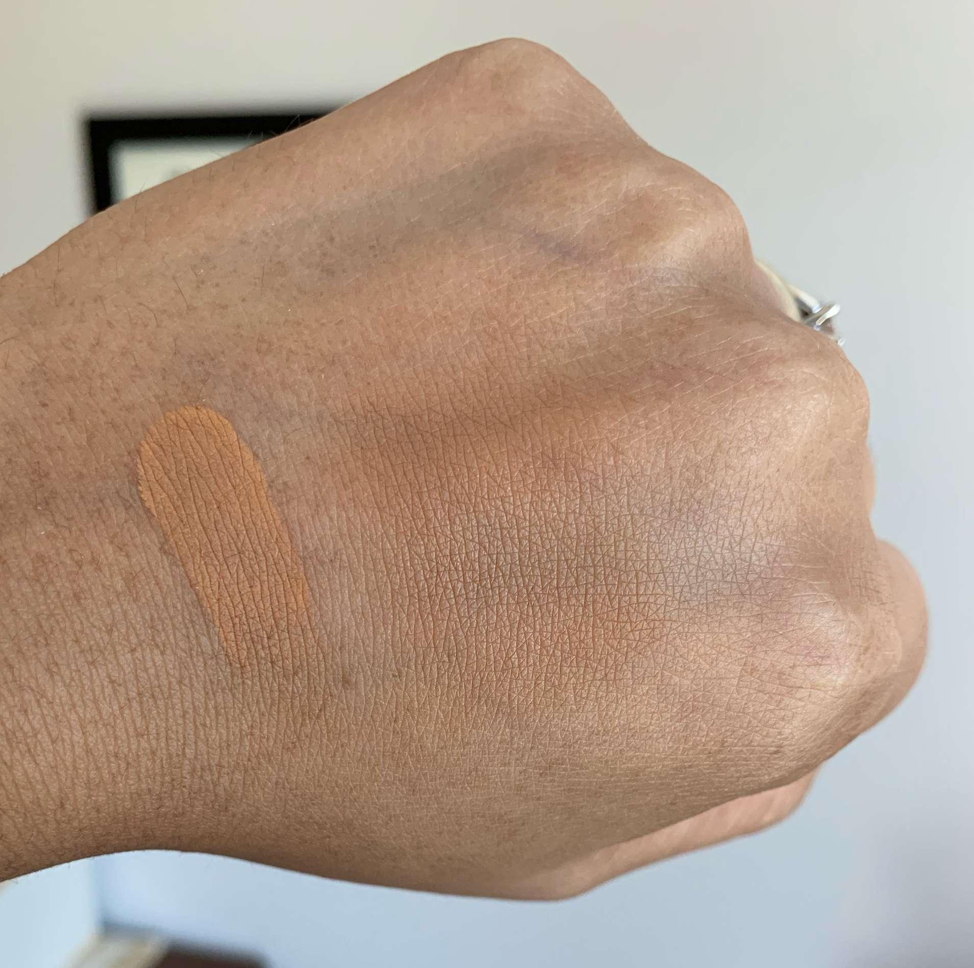 Too Faced Born This Way Powder Foundation Butterscotch Swatch on Medium Dark Skin