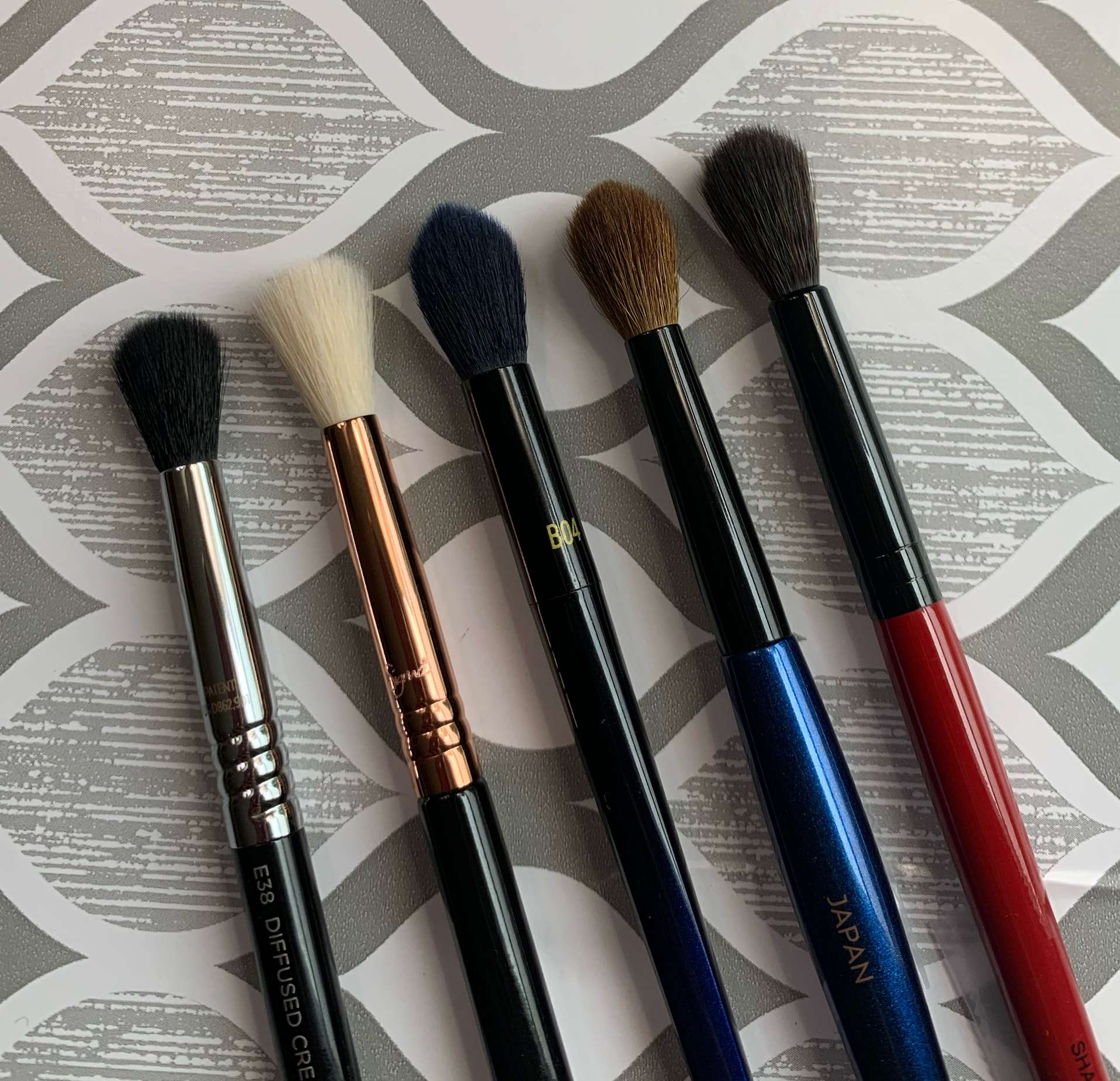 Brushes L to R: Sigma E38 diffused crease, Sigma E35 tapered blending, Real Techniques B04, Sonia G classic crease, Smashbox shadow (eye blending brush comparisons)
