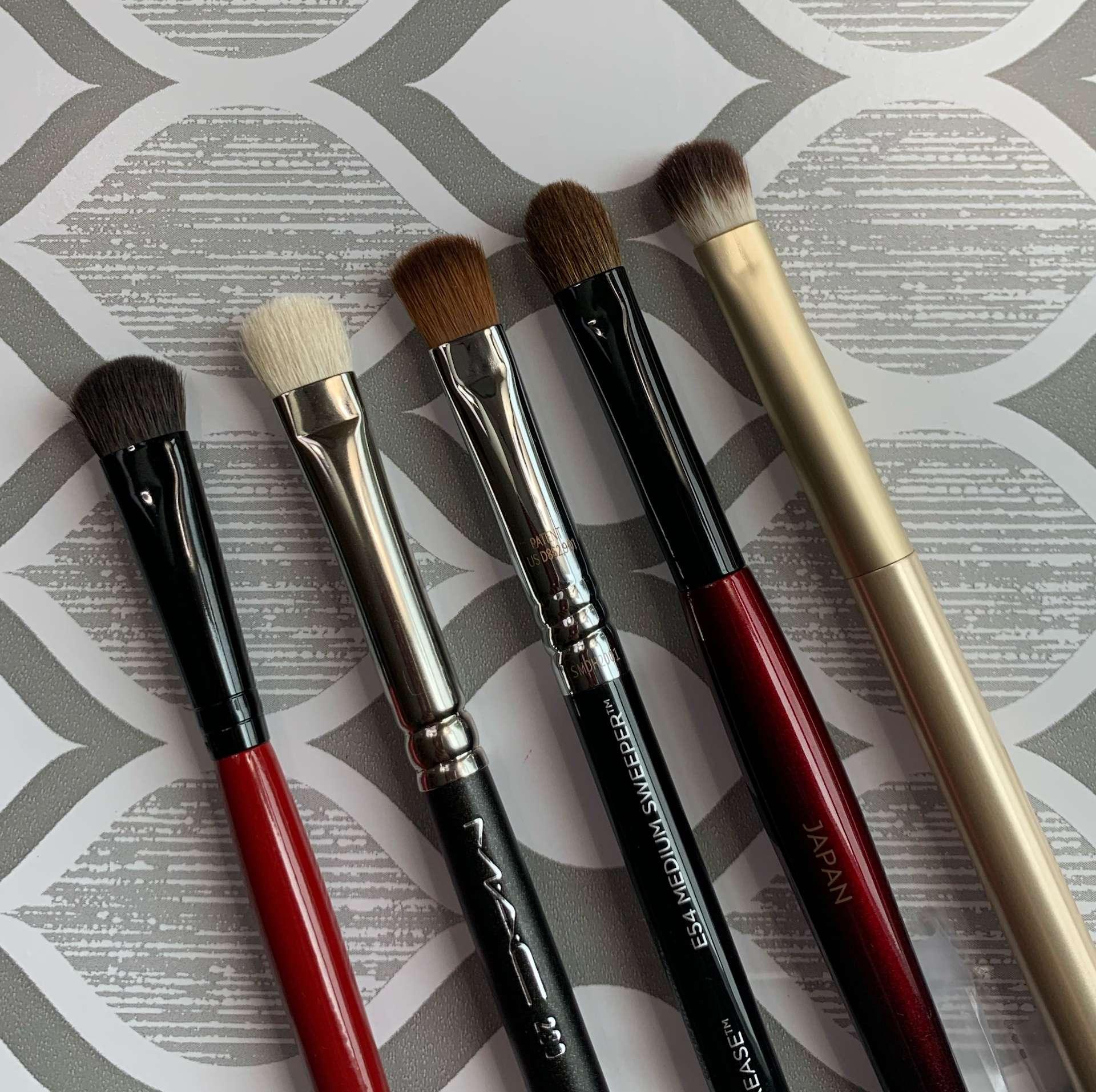 Brushes L to R: Smashbox full coverage shadow, MAC 239 natural hair, Sigma E54 medium sweeper, Sonia G builder pro, Sonia Kashuk small eyeshadow (eye shader brush comparisons))
